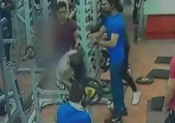 Man kicks, punches woman in gym
