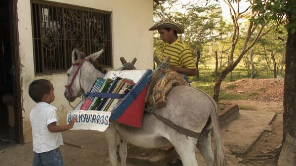 There's a Teacher Roaming Rural Colombia Atop Two Donkeys, Bringing a Mobile Library to Children