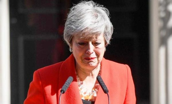 British PM Theresa May announces resignation in emotional speech